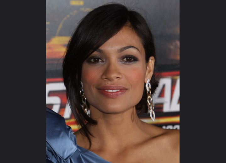 Rosario Dawson wearing her hair up