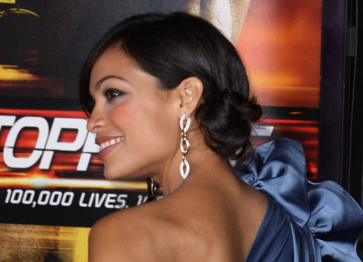 Rosario Dawson wearing her hair in an updo with side bun