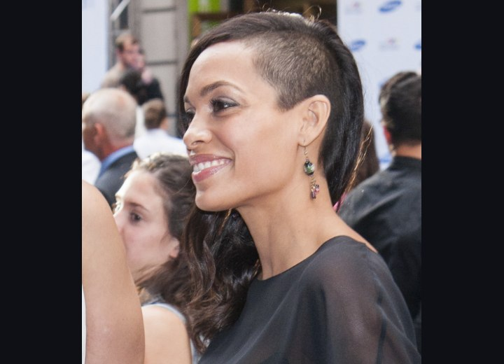 Rosario Dawson with half of her head shaved