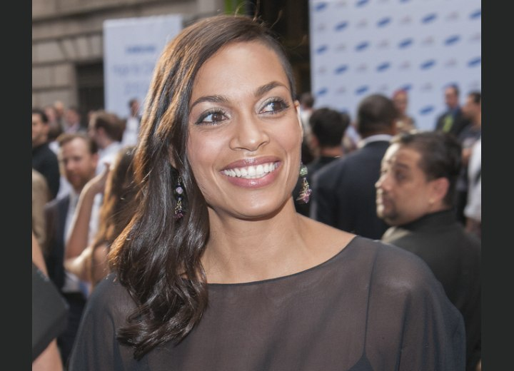 Rosario Dawson's long hairstyle with a shaved side
