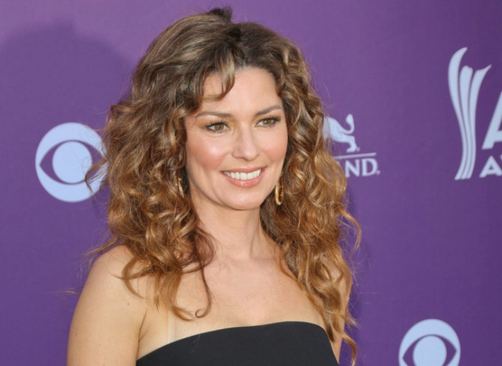 Shania Twain in her late forties and with long hair
