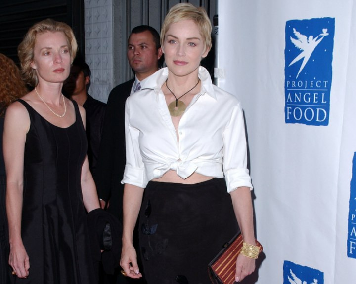Sharon Stone wearing her blouse knotted at her waist