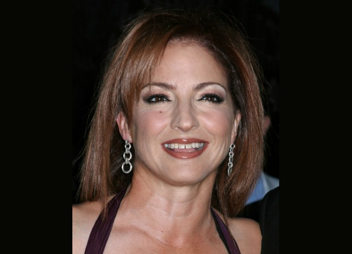 Gloria Estefan - Long straight hairstyle with undercut
