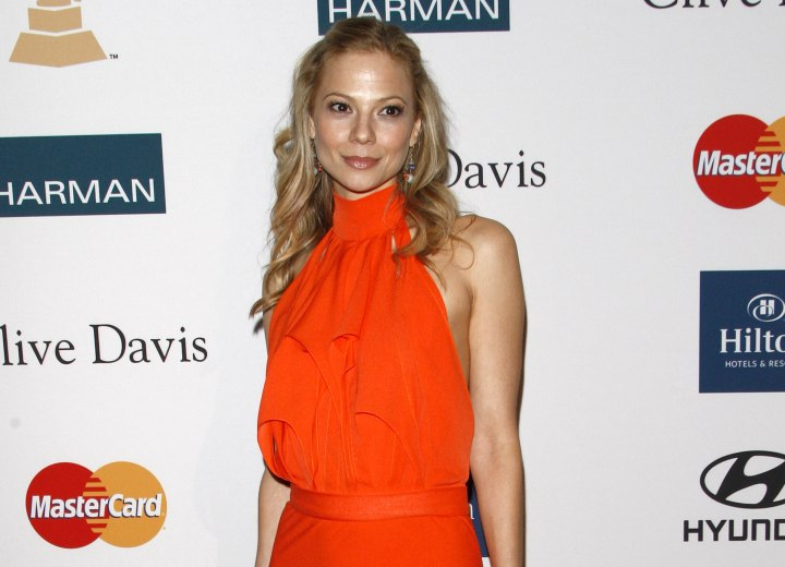 Tamara Braun wearing a long orange dress