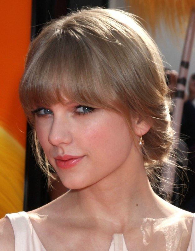taylor swift hair in a low updo for formal occasions