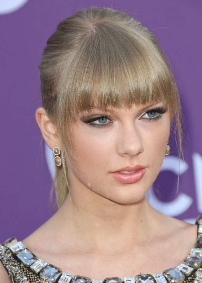 Ponytail Taylor Swift Hairstyle With Full Blunt Bangs