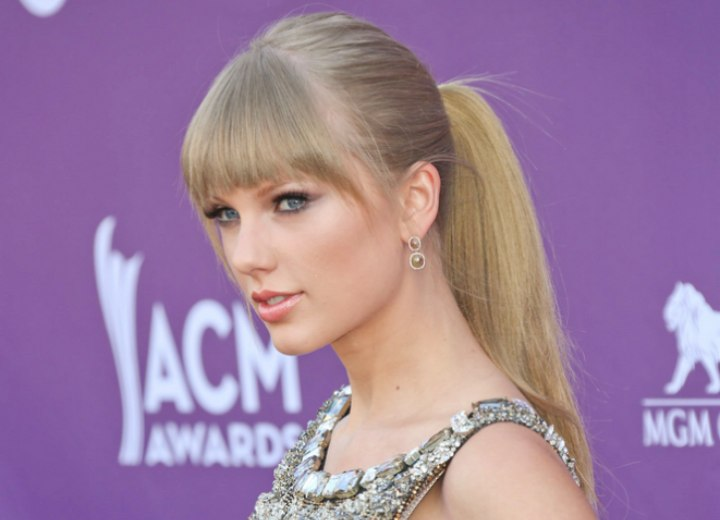 Taylor Swift  with bangs and a high ponytail