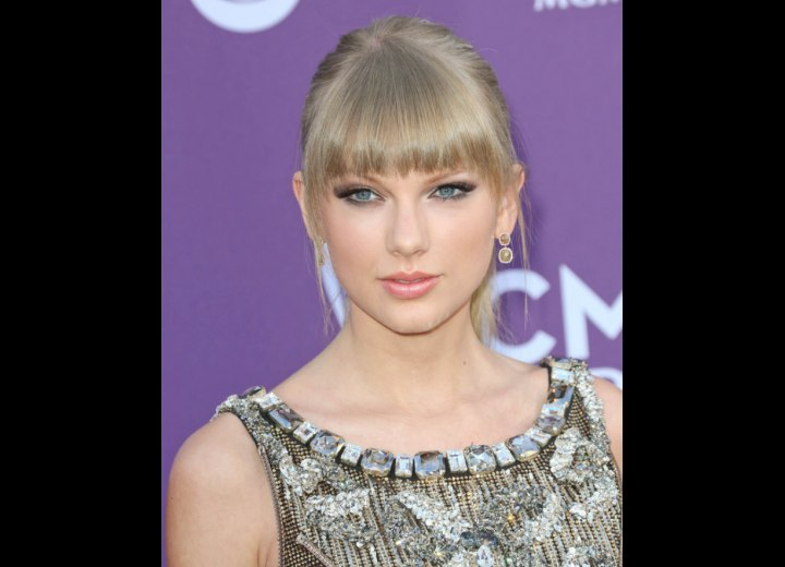 Taylor Swift's hair with rounded bangs to frame her face