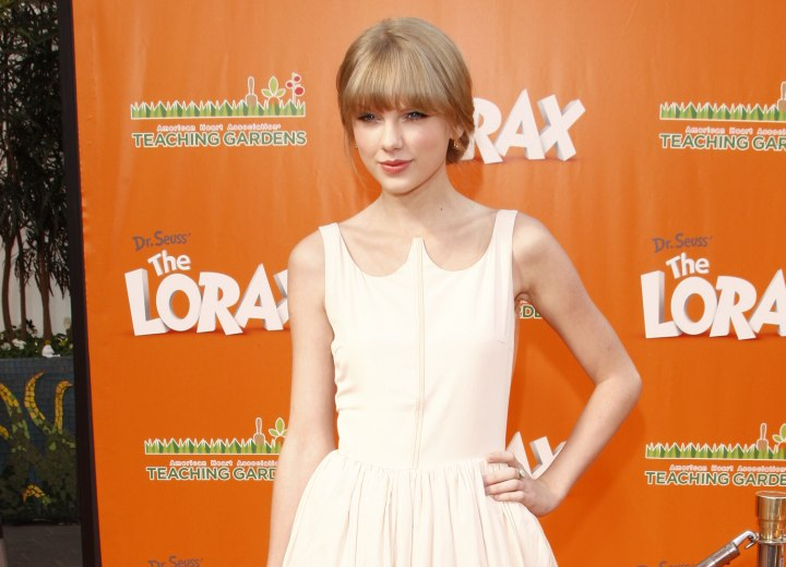 Taylor Swift look with a sweet dress and updo