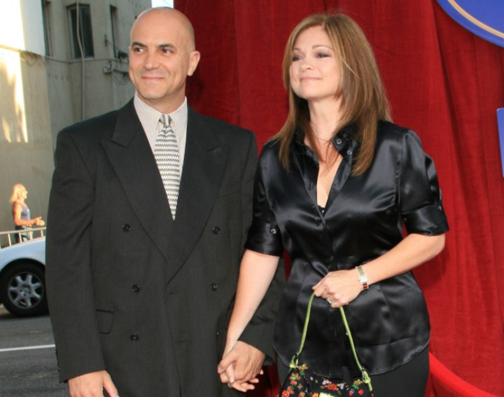Valerie Bertinelli wearing a black satin blouse