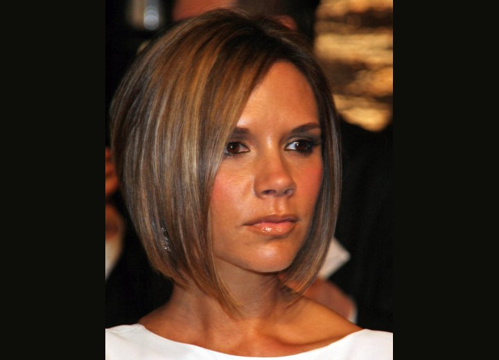 Victoria Beckham - Chocolate brown hair with highlights