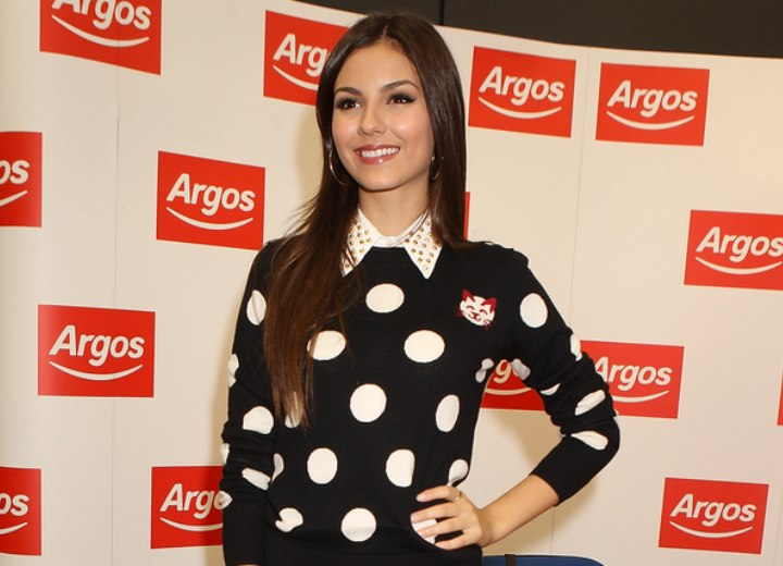 Victoria Justice wearing a blouse with studded collar and a polka dot sweater