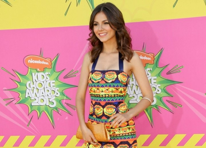 Victoria Justice look with a colorful short dress and fun hairstyle