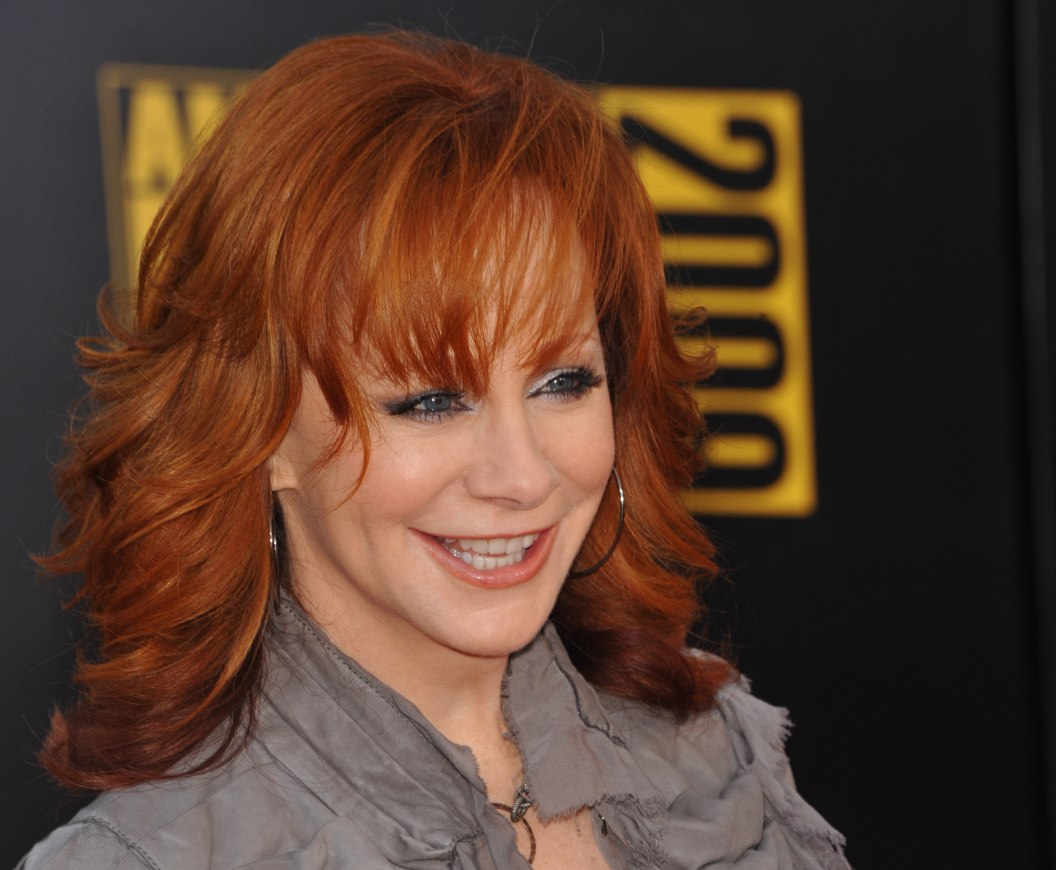Reba McEntire | Long chiseled hairstyle for 50 plus redhead women