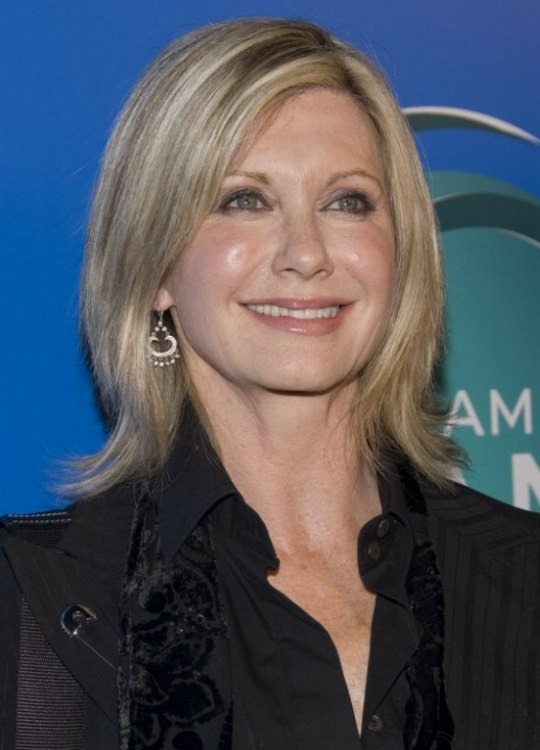 Olivia Newton John Wearing Her Hair In A Medium Hairstyle
