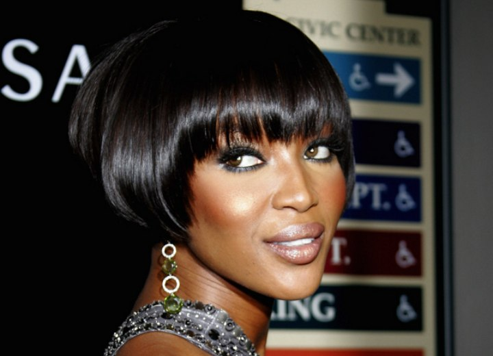 Naomi Campbell with short black hair