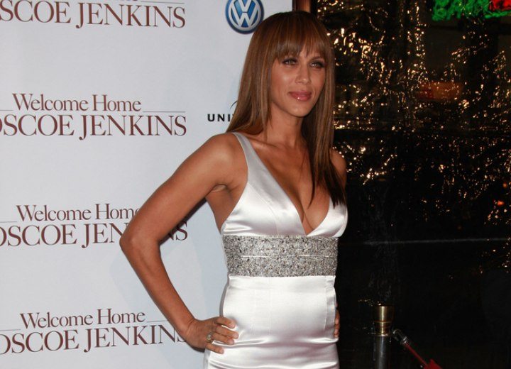 Nicole Ari Parker wearing a shiny silver dress