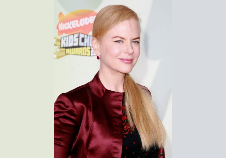 Nicole Kidman wearing her hair in a side ponytail