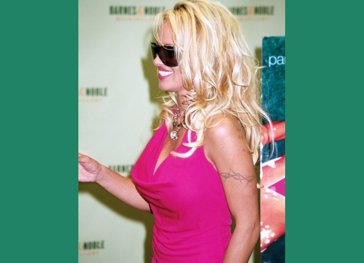 Side view of Pamela Anderson's long hairstyle