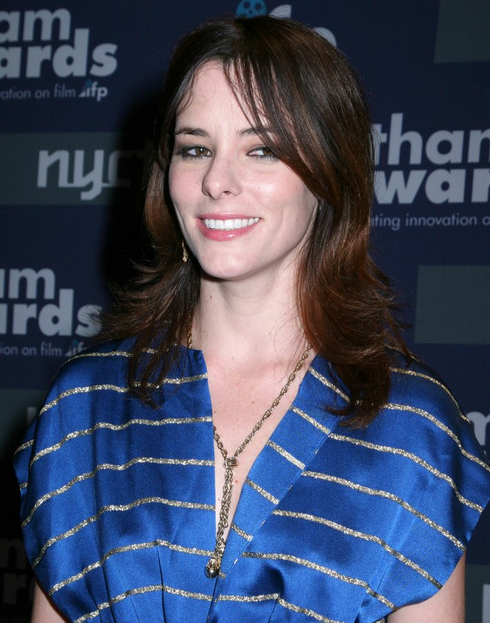 parker posey with long hair and bangs that hang along the sides