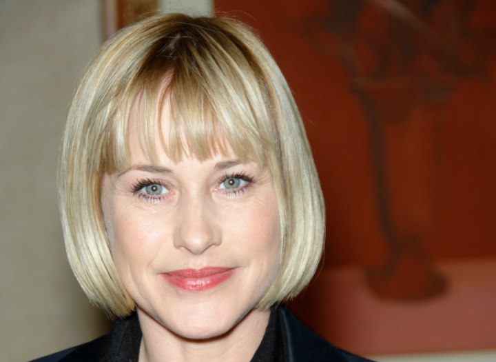 Bob haircut with short blunt bangs - Patricia Arquette