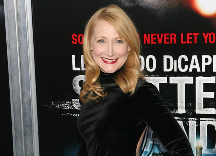 Patricia Clarkson wearing a shiny black turtleneck dress