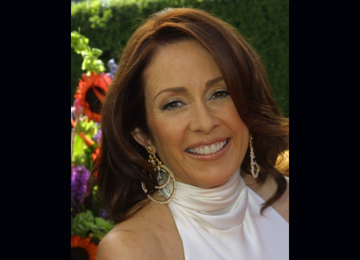 Patricia Heaton's hairstyle with layers and volume