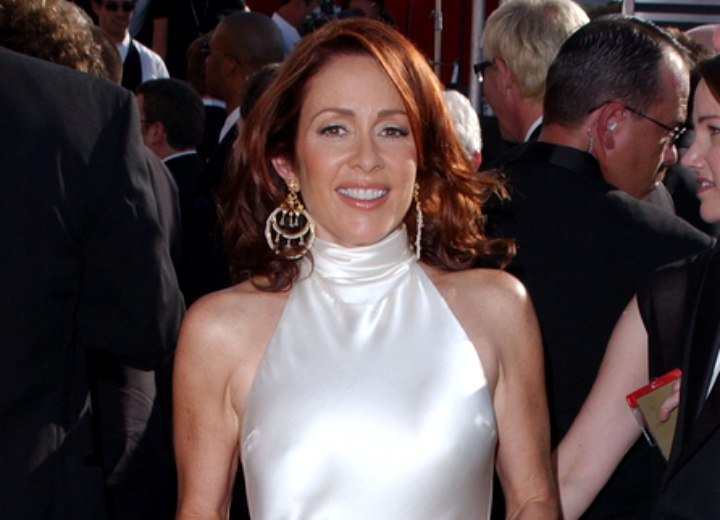 Patricia Heaton wearing a shiny halter turtleneck dress