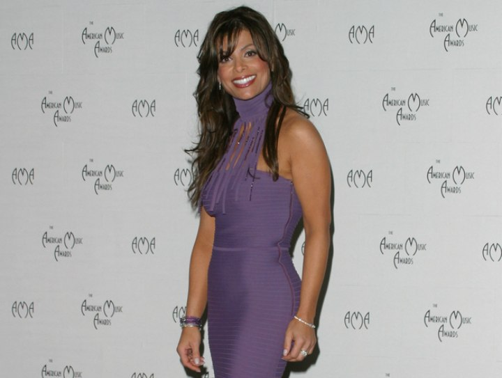 Paula Abdul wearing a high neck purple dress