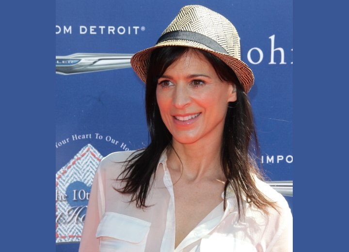 Perrey Reeves wearing a straw fedora hat