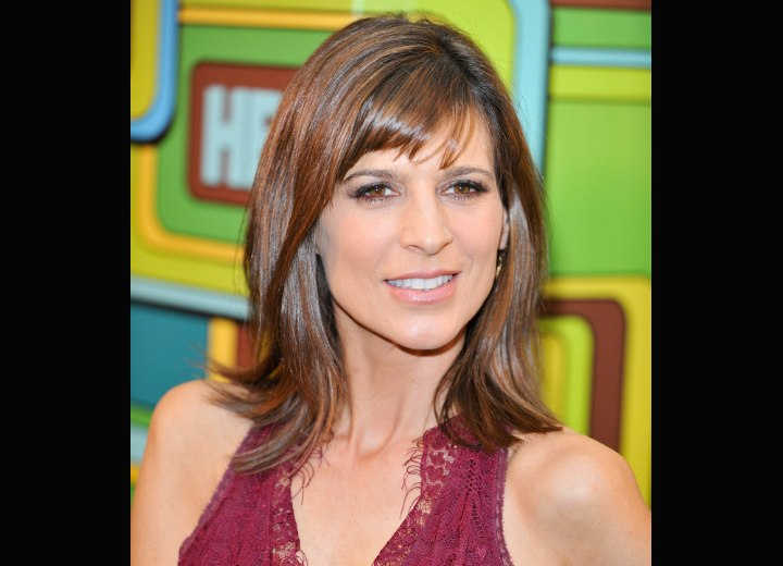 Hair with ends that flip up - Perrey Reeves