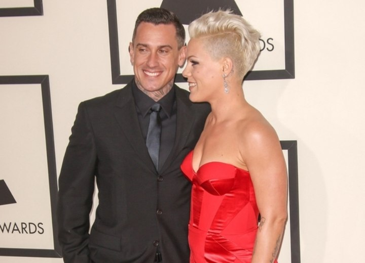 Pink - Hair in a Mohawk and a red dress