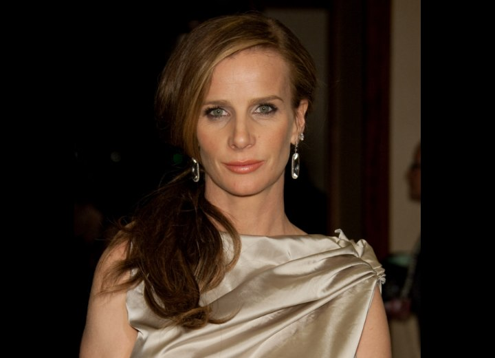 Rachel Griffiths with her hair styled in front of one shoulder
