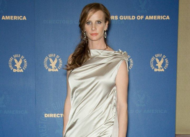 Rachel Griffiths wearing a silver satin dress