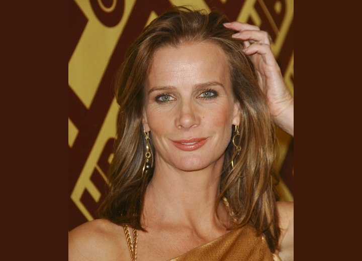 Long face reavealing hairstyle - Rachel Griffiths