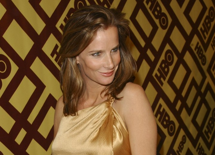 Rachel Griffiths wearing a shiny gold dress