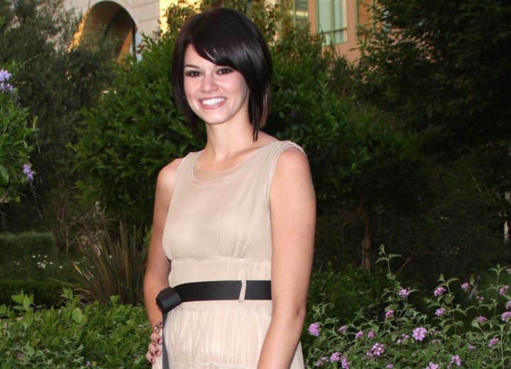 Rachel Melvin look with dark hair and a beige dress