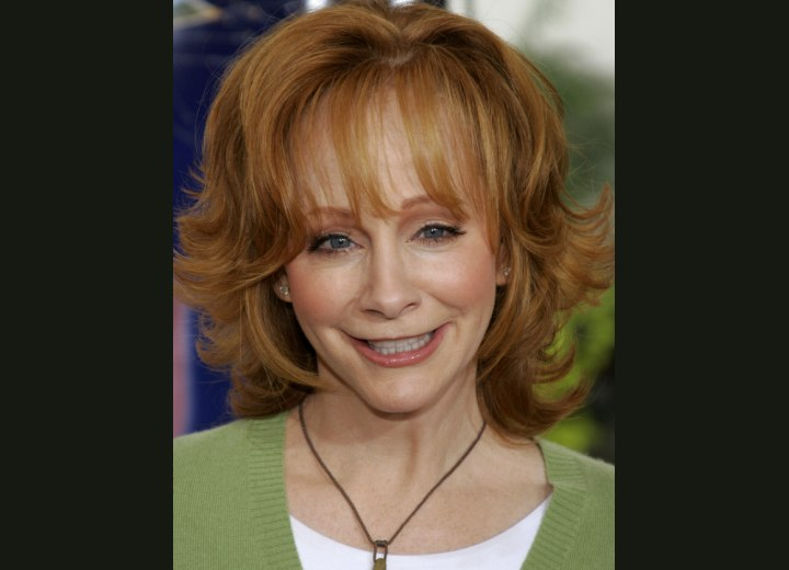 Practical hairstyle for women aged over 50 - Reba McEntire