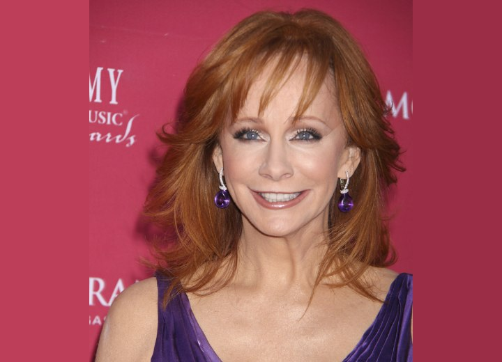 Reba McEntire - Long layered hairstyle with feathering