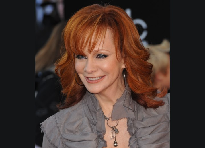 Long red hair with flipped out ends - Reba McEntire