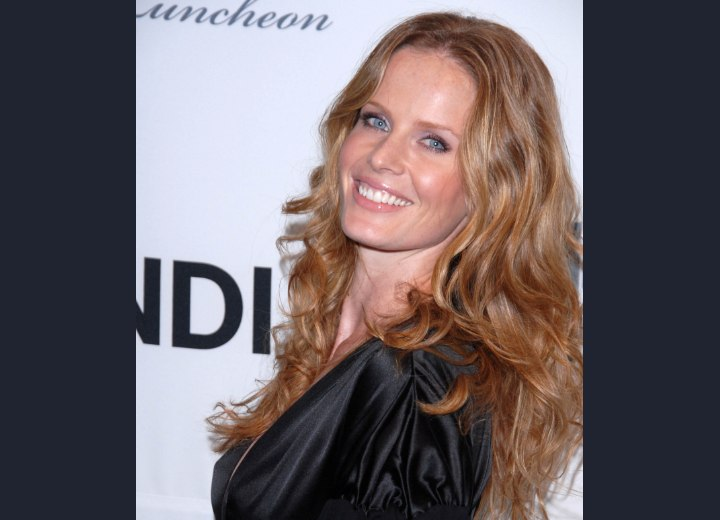Rebecca Mader wearing her hair long with bouncy curls
