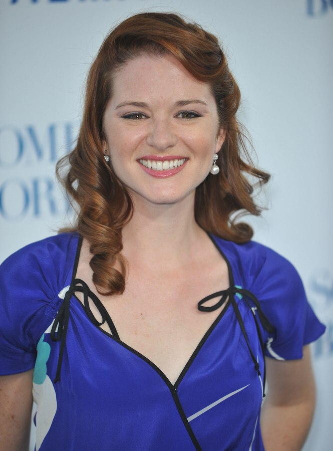 Sara Rue With Her Reddish Brown Hair Styled Into Spiral Curls