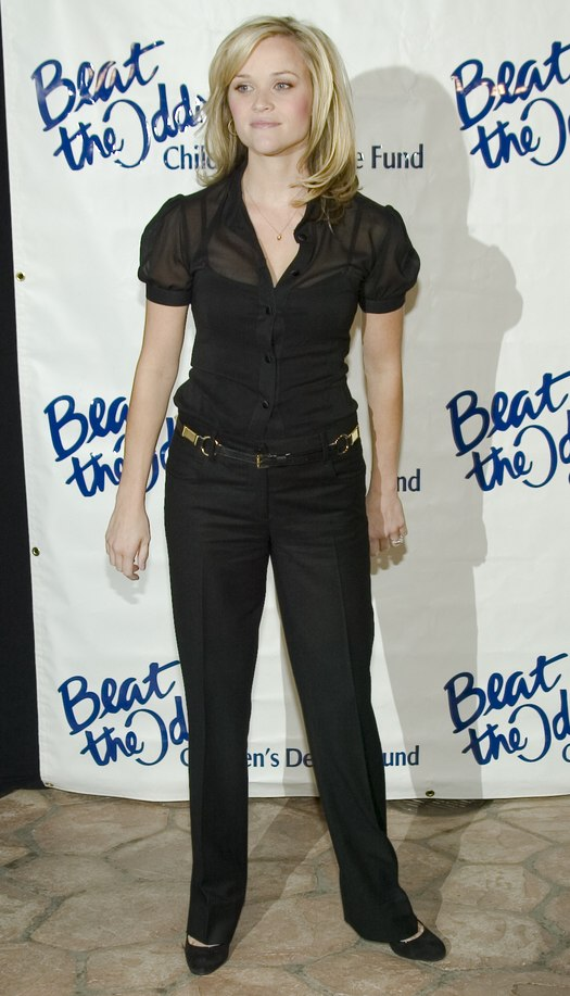 Reese Witherspoon With Shoulder Length Hair And Wearing A Sheer Black Blouse