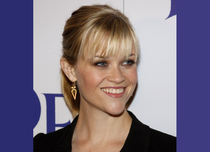 Bangs cut at the eyebrows - Reese Witherspoon