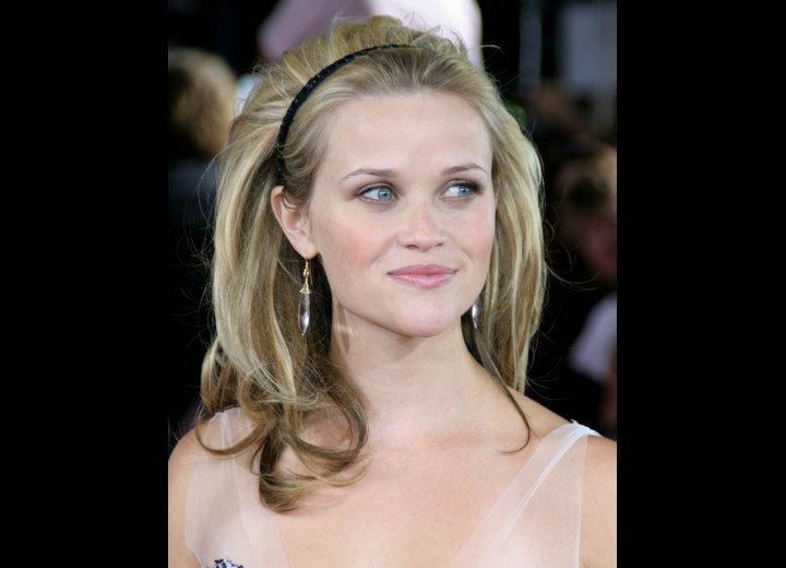 Reese Witherspoon with her long hair styled for wolume