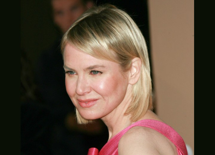 Renee Zellweger with her hair styled behind one ear