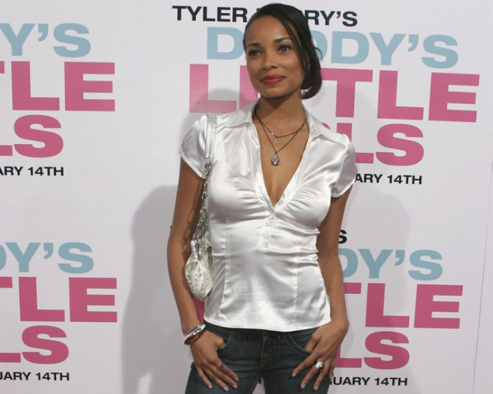 Rochelle Aytes wearing jeans and a white satin blouse