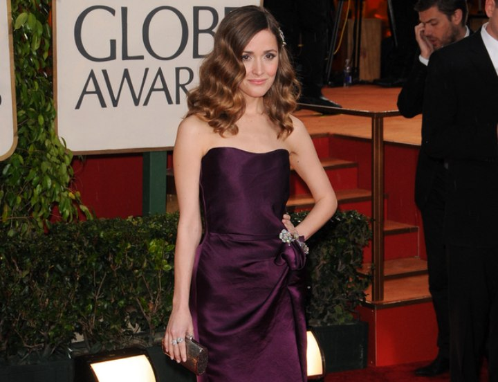 Rose Byrne wearing a plum evening dress