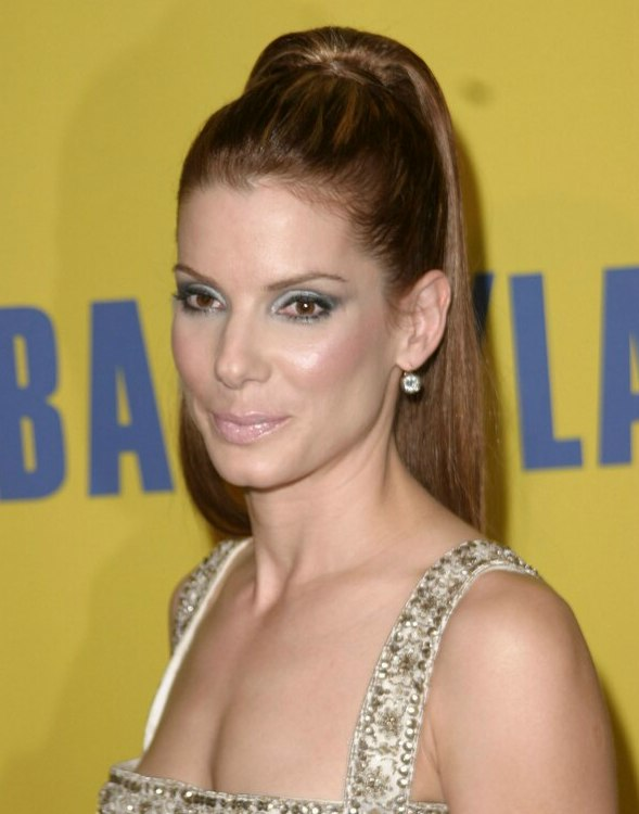 Sandra Bullock Wearing Her Hair In A High Top Ponytail