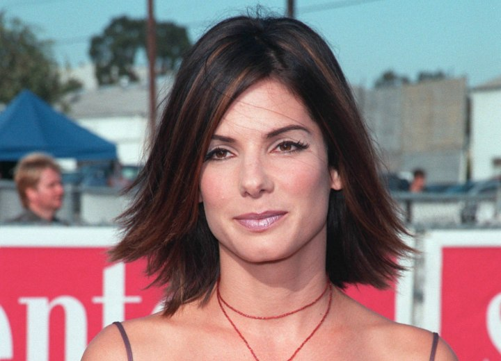 Sandra Bullock with medium length hair and highlights